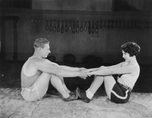 exercise-vintage-couple-stretching-